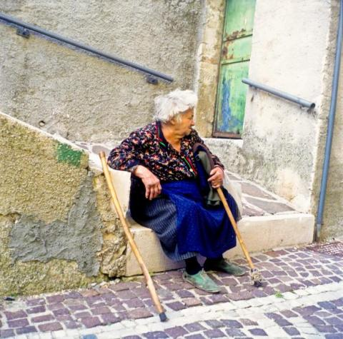 Woman Sat in Miranda, Italy